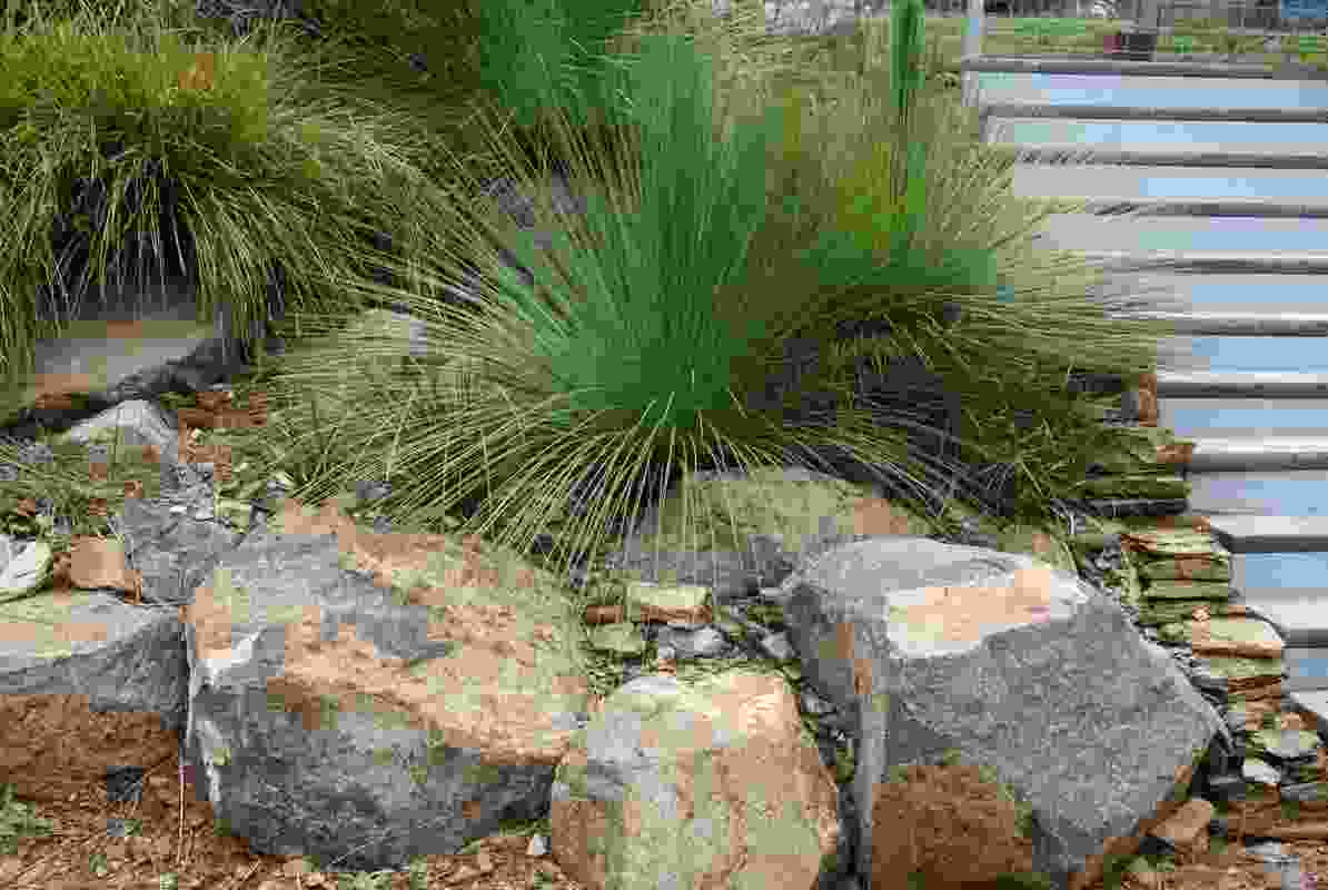 Extensive use of salvaged materials included large rocks and shale gravel.