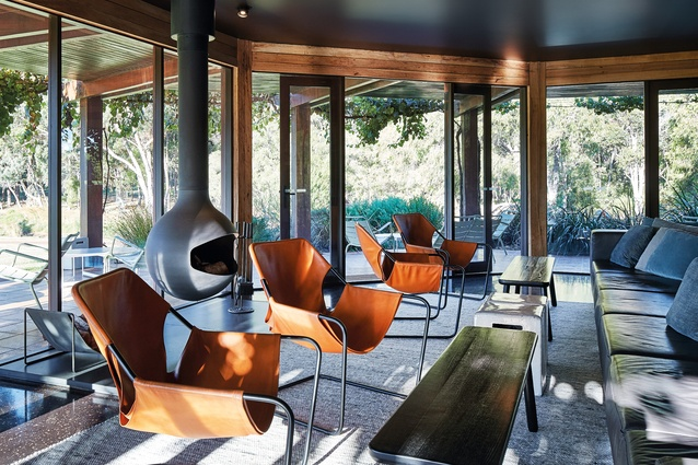 Overlooking the vineyard, the wine lounge is furnished with a comfortable leather lounge, leather-slung armchairs, ceramic side tables and blackened oak tables.