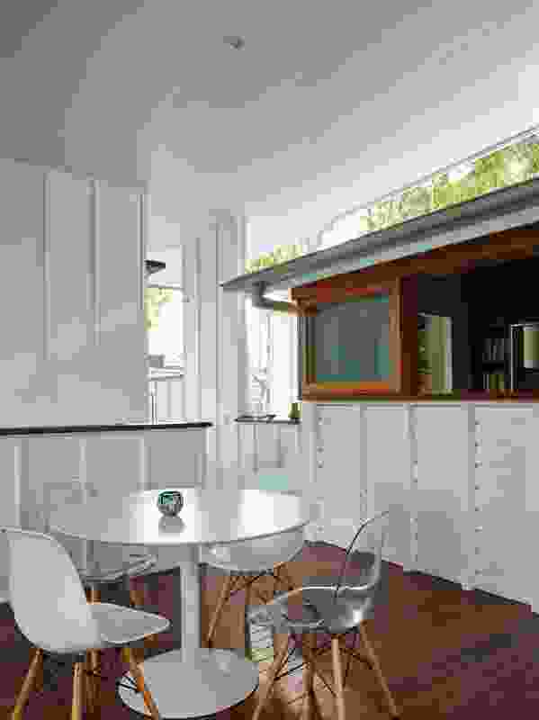 A long sliding window provides a servery that connects the kitchen to the covered deck.