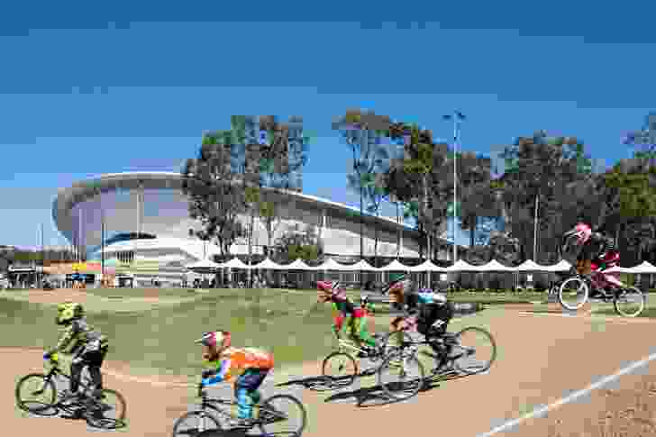 The velodrome's hyperbolic paraboloid roof creates an impressive backdrop to the nearby BMX Supercross Track.