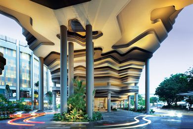 """The heavy yet """"eroded"""" base of the building represents WOHA's interest in """"topographical architecture."""""""