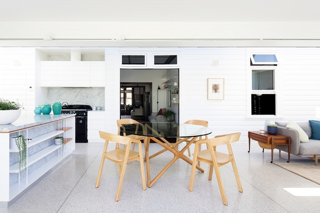 The extant weatherboards have been cleverly incorporated into the finely detailed kitchen joinery.