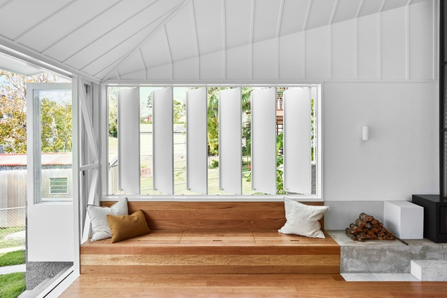 The garden room steps down with the fall of the terrain as the timber floor folds to create a bench seat by the window.