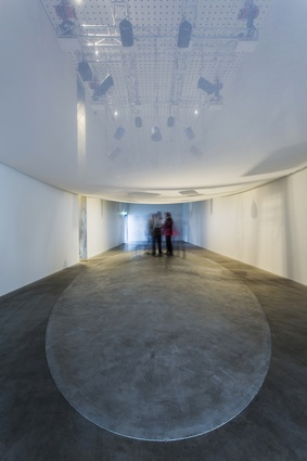 Sixty speakers are either suspended above visitors or concealed in the floor and walls.