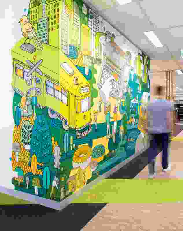 The office's graphic murals use colour to differentiate between floors.