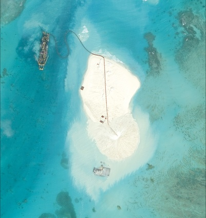 Johnson South Reef, photographed in January 2014. Before dredging the only structure here was a small concrete platform that housed a communications facility, garrison building and pier.