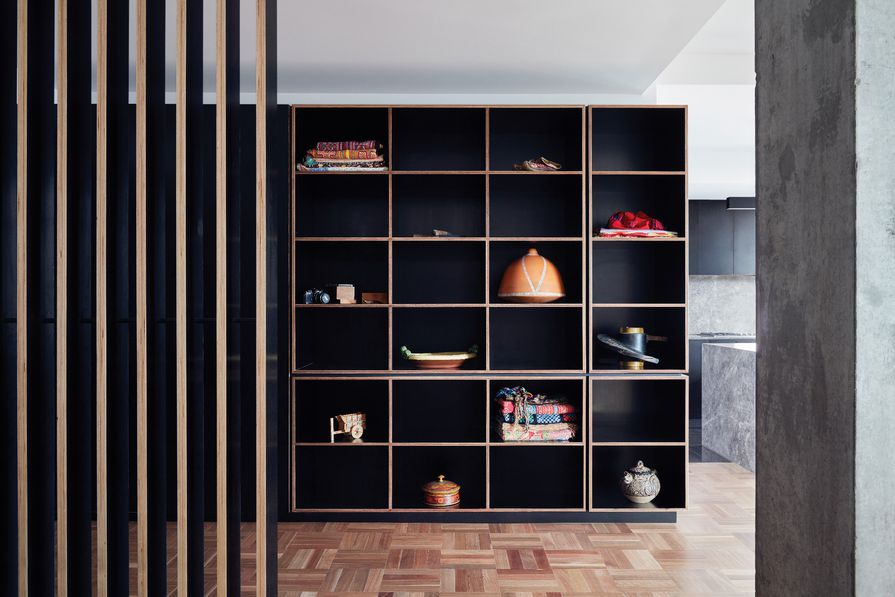 Minimalist shelving at Queen Street Apartment provides a backdrop for beautiful objects.