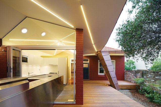 The new kitchen extends into an indoor/outdoor barbecue area.