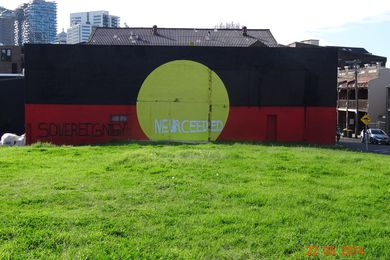An inscription over the Aboriginal flag on the back of a gym in Redfern, 22 June 2014.