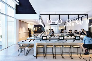 The design of the sushi train was inspired by subway stations. it features subway tiles and glowing led rings that are reminiscent of train handles.
