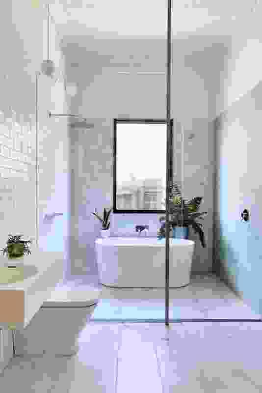 A bathroom in Garden House by BKK Architects.