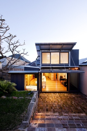 The courtyard works as an extension of the living space.