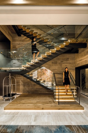 The new stair connects the ground and first floors and echoes the grand staircases of the nearby theatre in an understated way.