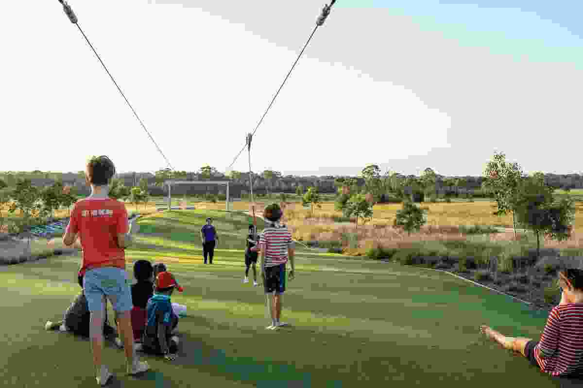 Visitors at play on the park's extensive flying fox, designed for both adults and children.