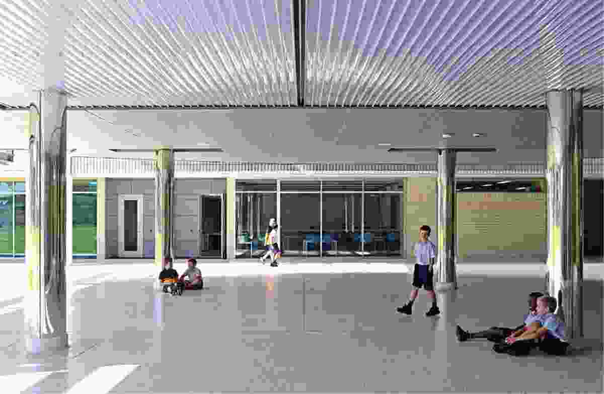 An undercroft at the southern end of the building provides a sheltered play area and a space for alfresco parent dinners.