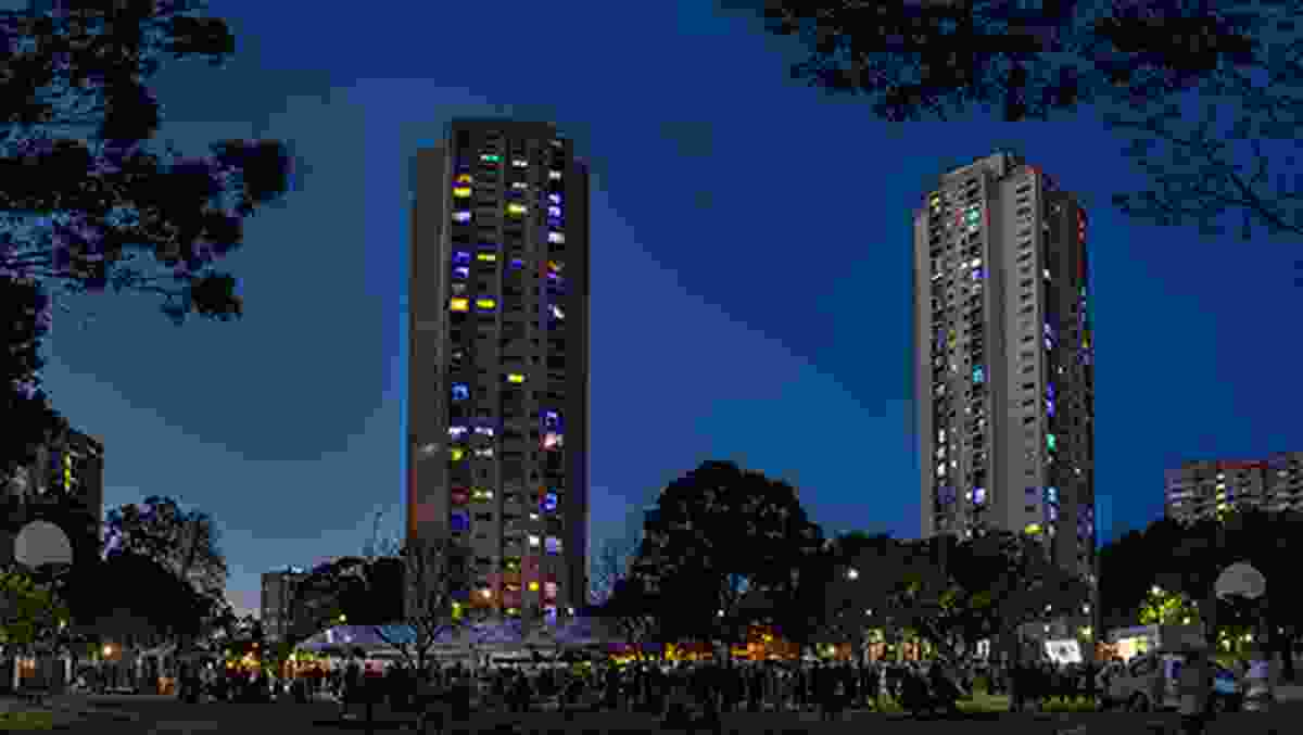 """The Matavai and Turanga public housing towers lit up as part of the """"We Live Here"""" campaign."""