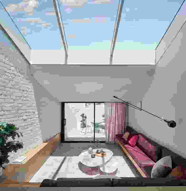 The generous skylight delineates the dining room and sunken lounge, while also exaggerating volume within the living area.