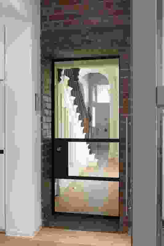 A glazed door separates the front and rear wings on the ground floor.