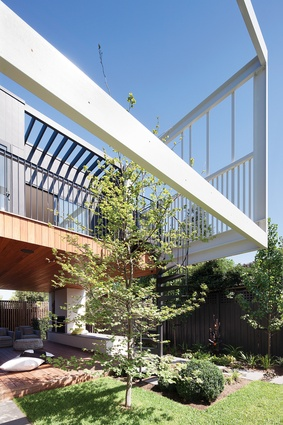 The courtyard forms the organizational device at Stepping House, with both levels connected to this outdoor area.