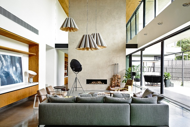 The double-height living area opens to the rear garden, the lofty space made to feel even more airy by its connection to the outdoors. Artwork: Susan Knight and Trevor Mein.