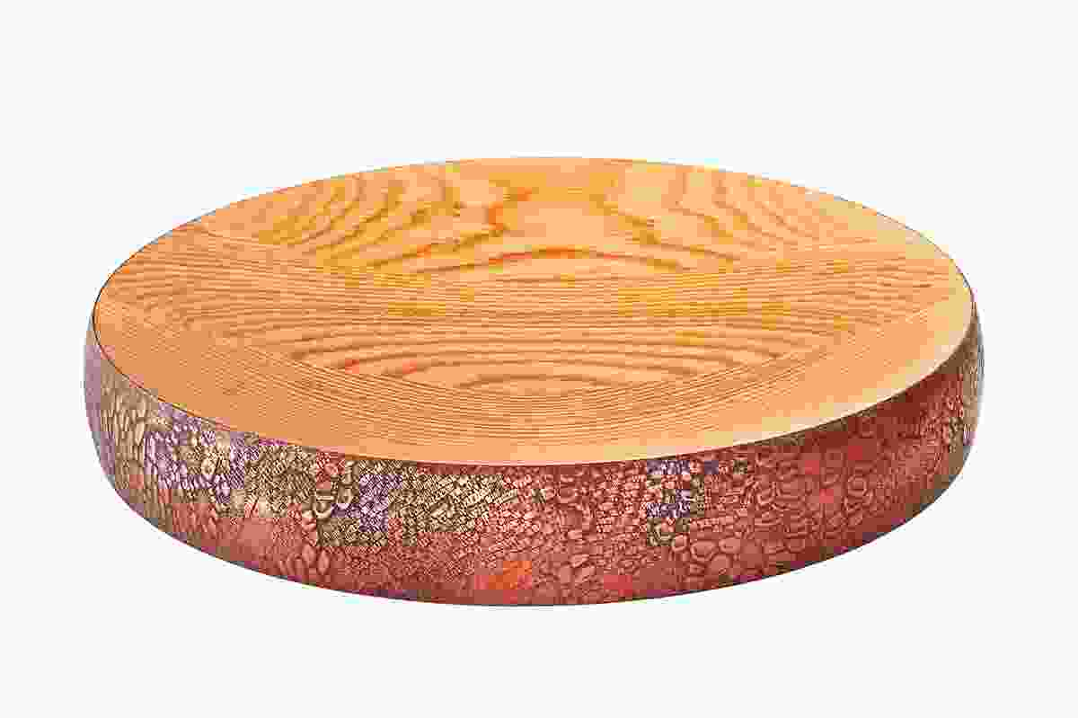 Kodiak is a range of timber bowls designed by Ben Wahrlich with a metal texture around the perimeter.
