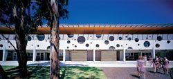 The double-storey verandah with its signature63-metre-longprecast concrete screen.