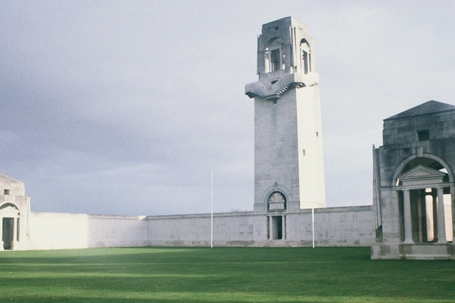 The Villers-Bretonneux memorial, designed by Sir Edwin Lutyens. The 30.5-metre-high tower is central to three sides of a quadrangular wall with a pavilion at each end. On its top, a horizontal dial indicates the direction of London, Paris, Berlin and Canberra.