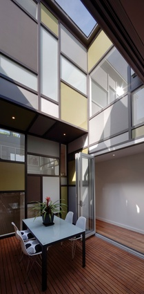 The house pivots around a central courtyard and stair.