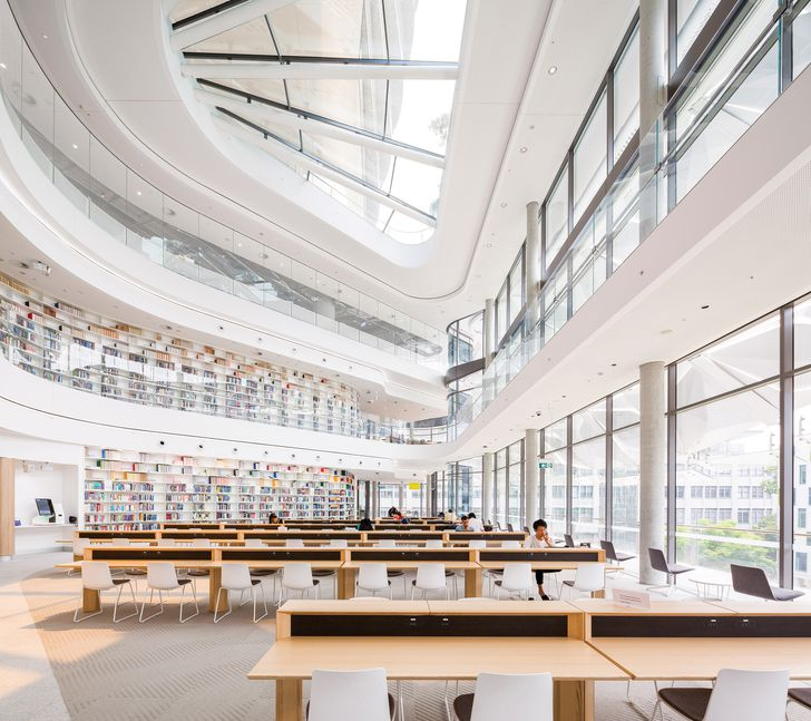 The triple-height atrium of the Reading Room is topped by a large skylight while the glass facade maximizes light and employs operable louvres for shading.