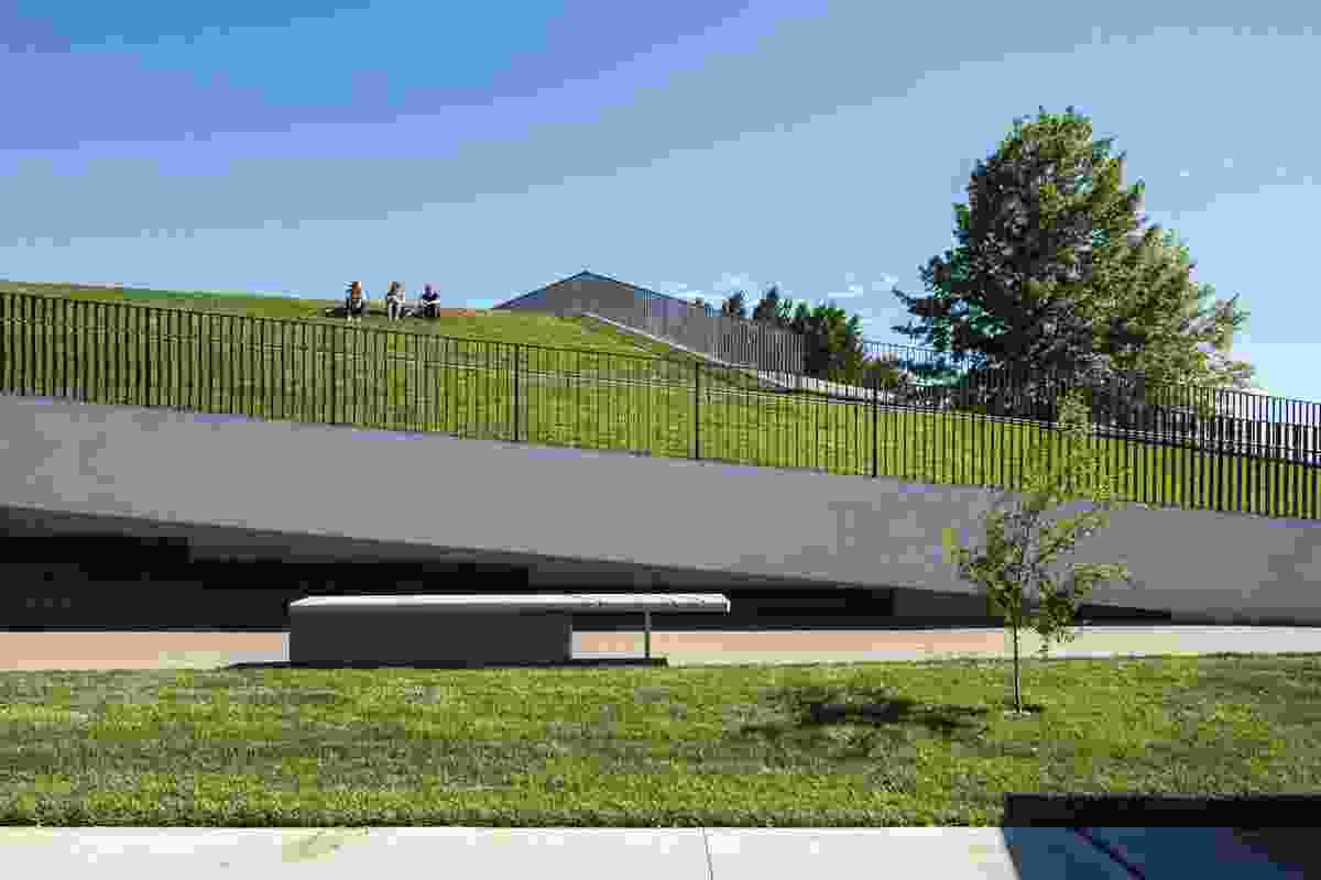 The expansive, continuous sloping green roof is largely unprogrammed; locals have embraced the new public space and new uses for it continue to be explored.