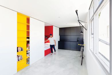 Primary colours are concealed or revealed as the occupant modifies the space with the sliding panels to suit the activity.