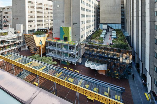 The sober plan and existing buildings are overlaid with a cacophony of colour and architectural expression. Landscape architects TCL created terraces on the rooftops and one at street level, featuring Peter Elliott's relocated Bowen Terrace Loggia.