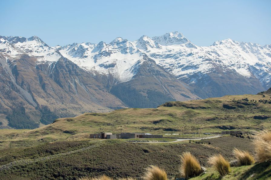 Dwarfed by the steep Richardson Range in an isolated patch of Central Otago, Aro Hã blends into the landscape with its serrated rooflines, timber exteriors and schist detailing.