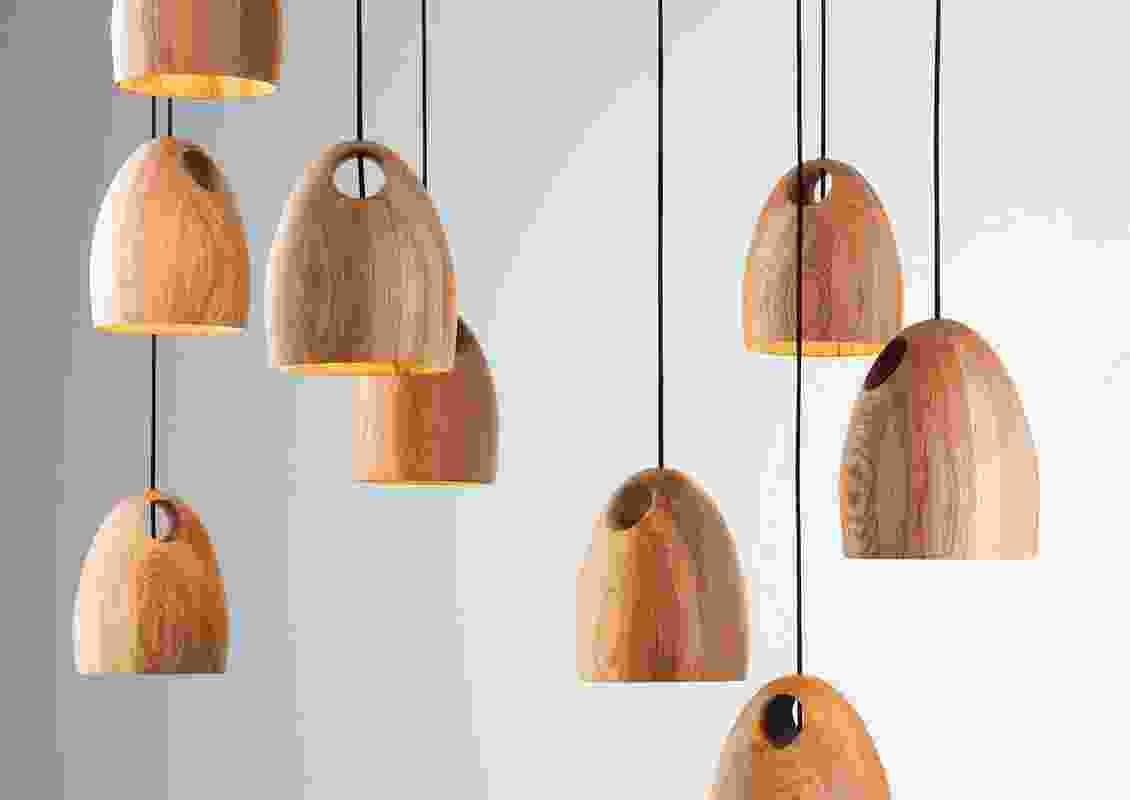 Oak pendant lights by Ross Gardam.