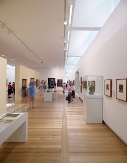 The scooping of natural light into the gallery spaces and human scale are integral to the display of the portraits.
