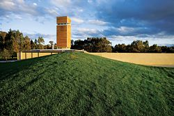 The tower rises prominently from the tasting room, hidden from the road under a large grass berm. Image: Kraig Carlstrom