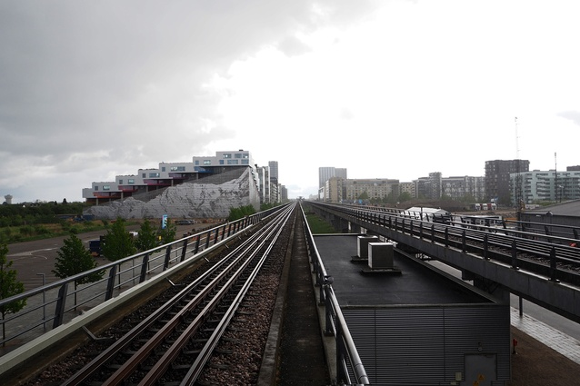 View from Ørestad station, with Mountain Dwellings by Bjarke Ingels Group and JDS Architects (2008) on the left.