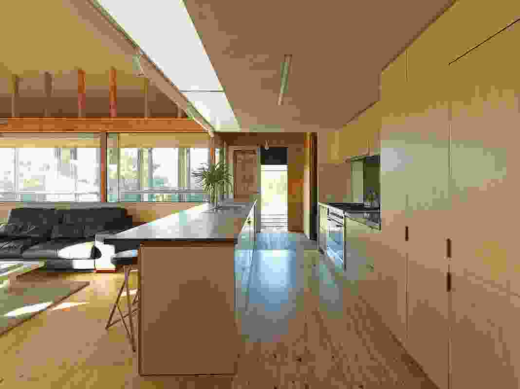 The light well terminates above the kitchen bench and acts as a downlight.