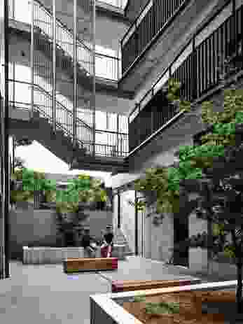A central courtyard serves as a lobby and provides greenery, light and ventilation.