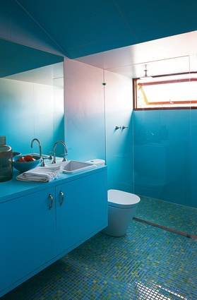 A playful blue bathroom on the upper level provides some joy in a usually mundane room.