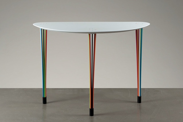 The Carousel Table is a contemporary restyling of the classic Louis XVI console.