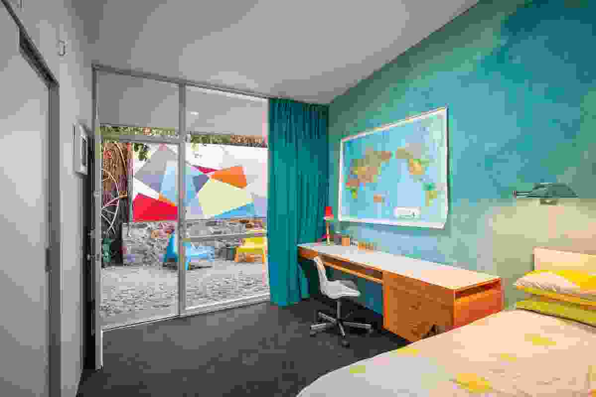 The house is now more vibrant in tone than Seidler's original scheme, with primary hued curtains in each child's bedroom and an  abstract external mural.
