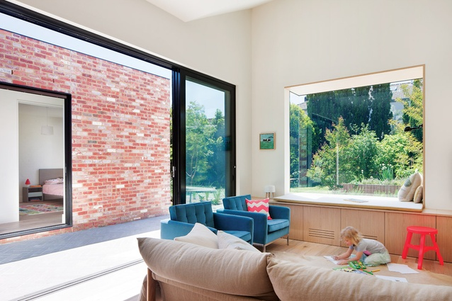 Large glass sliding doors on each wing allow the parents to keep an eye on young children.