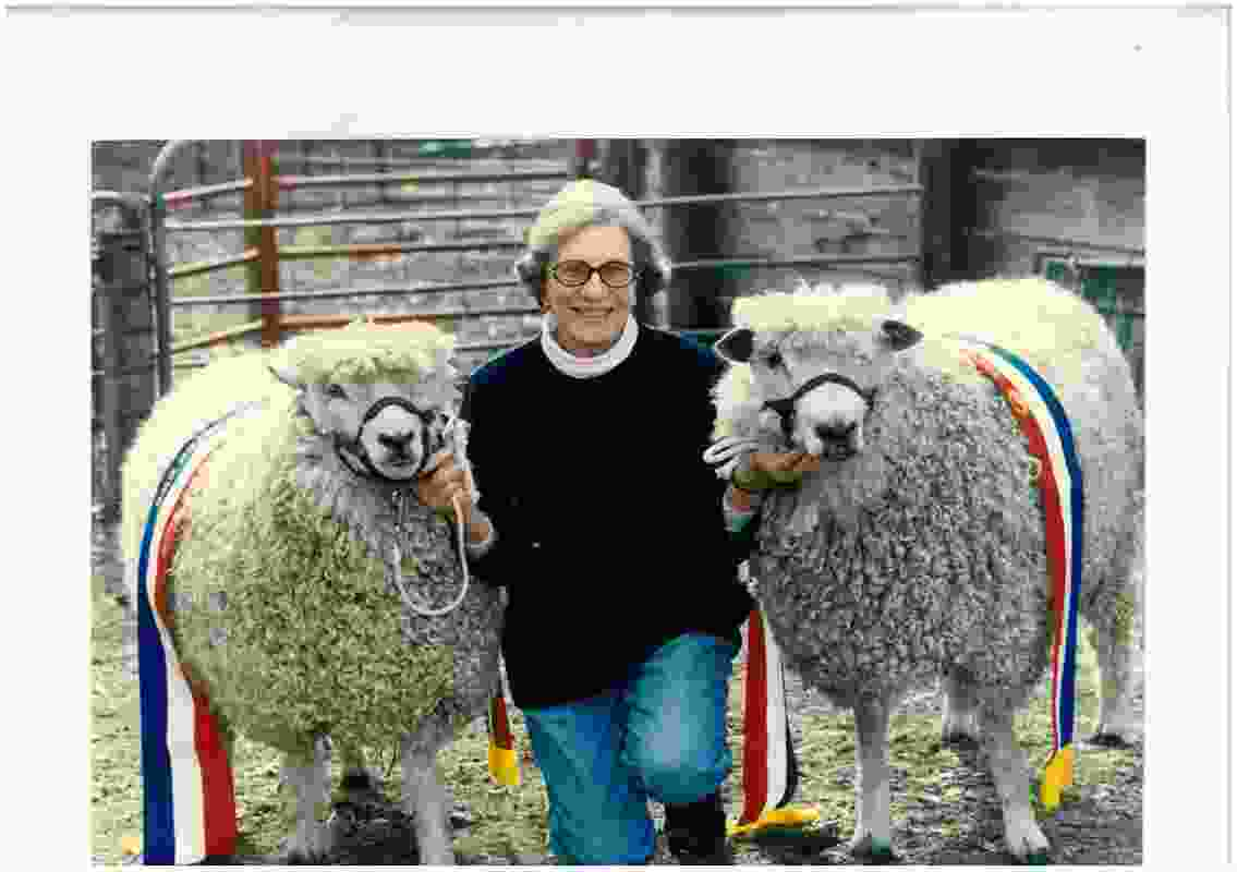 Ethel Margaret Stephenson with two prize-winning sheep.