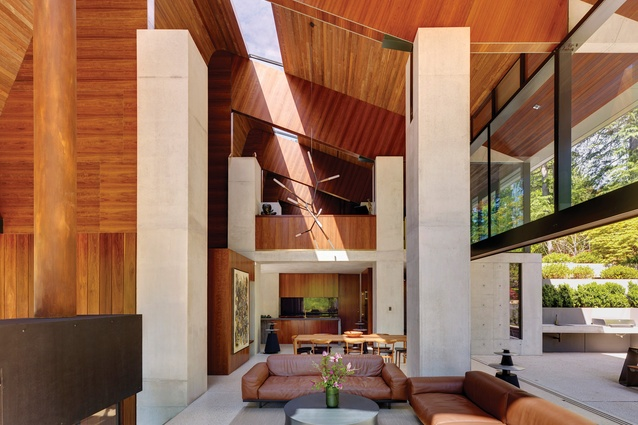 A skylight in the high ceiling cut the house in two along its longitudinal length.