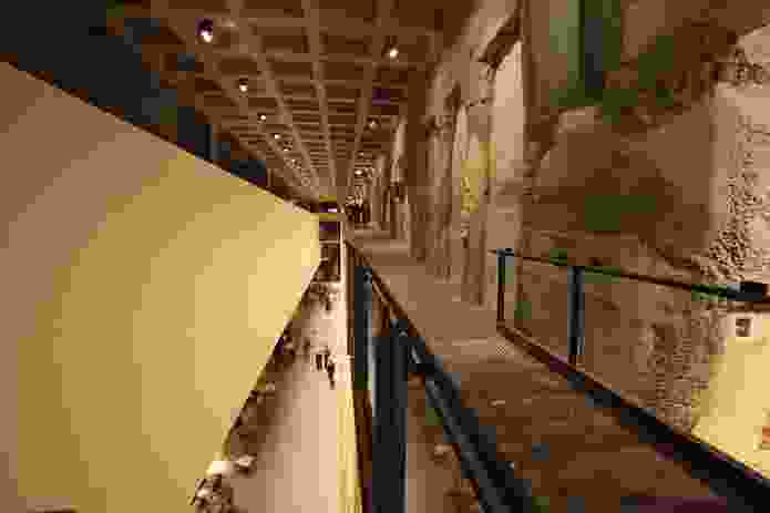 A walkway on level B1 peers through a void to the lower levels.