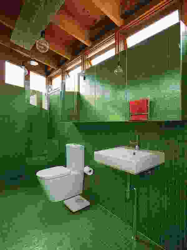 The vibrant green glass-mosaic-tiled ensuite.