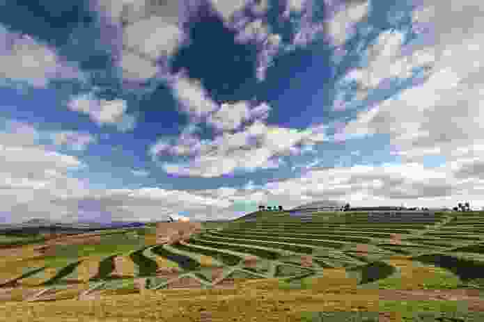 Two buildings, sitting atop prominent spurs and separated by a grassed amphitheatre, serve as sentinels within the landscape.