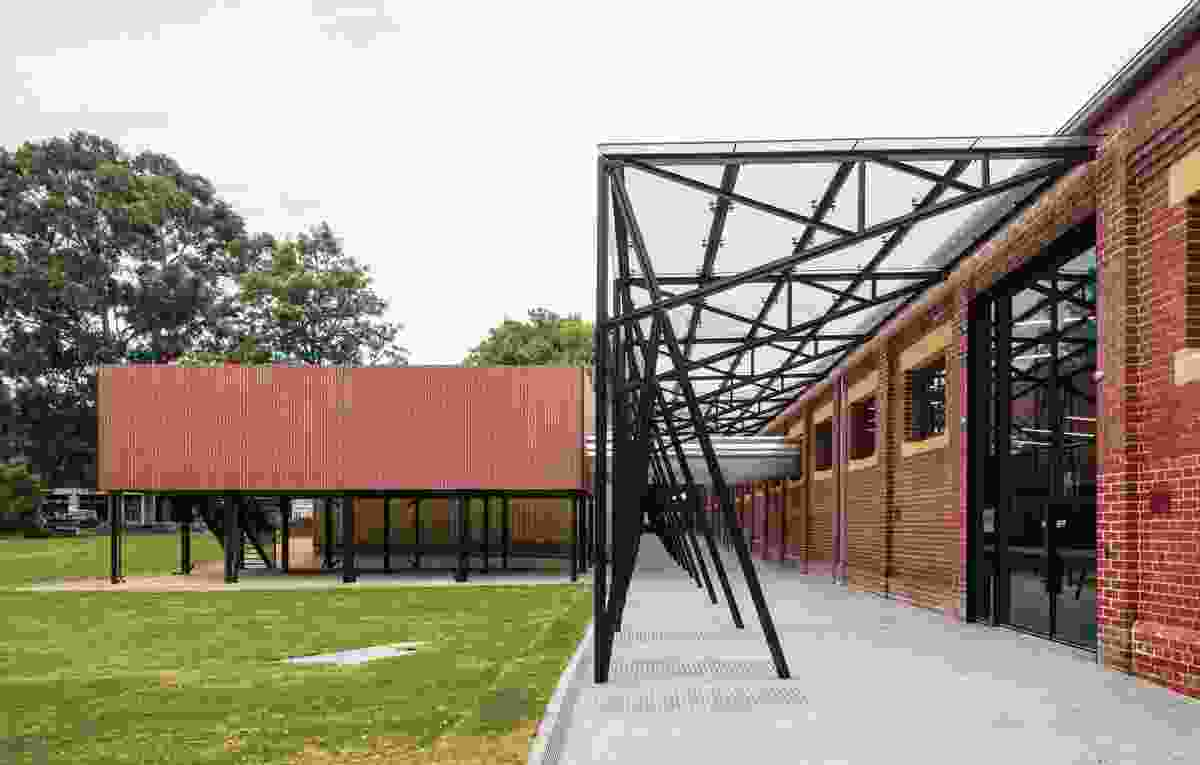 Two external blocks in red brick house new services, minimizing the impact of these services on the heritage building.
