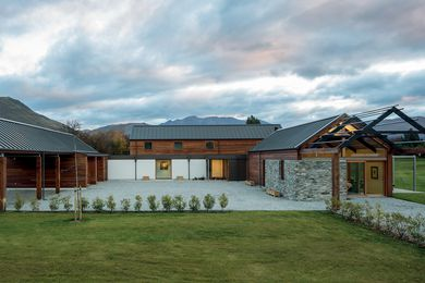 The house comprises three interconnected pavilions formed around a central entry court, much like the traditional grouped farm buildings on which the design is based.